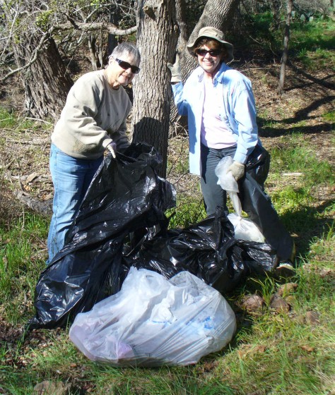 Pat and Cathy cleaning up the trails.  (Courtesy of Paula Richards)