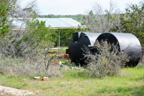Water tanks sit next to the collection shed waiting to be installed. (Courtesy of Phil Wyde)